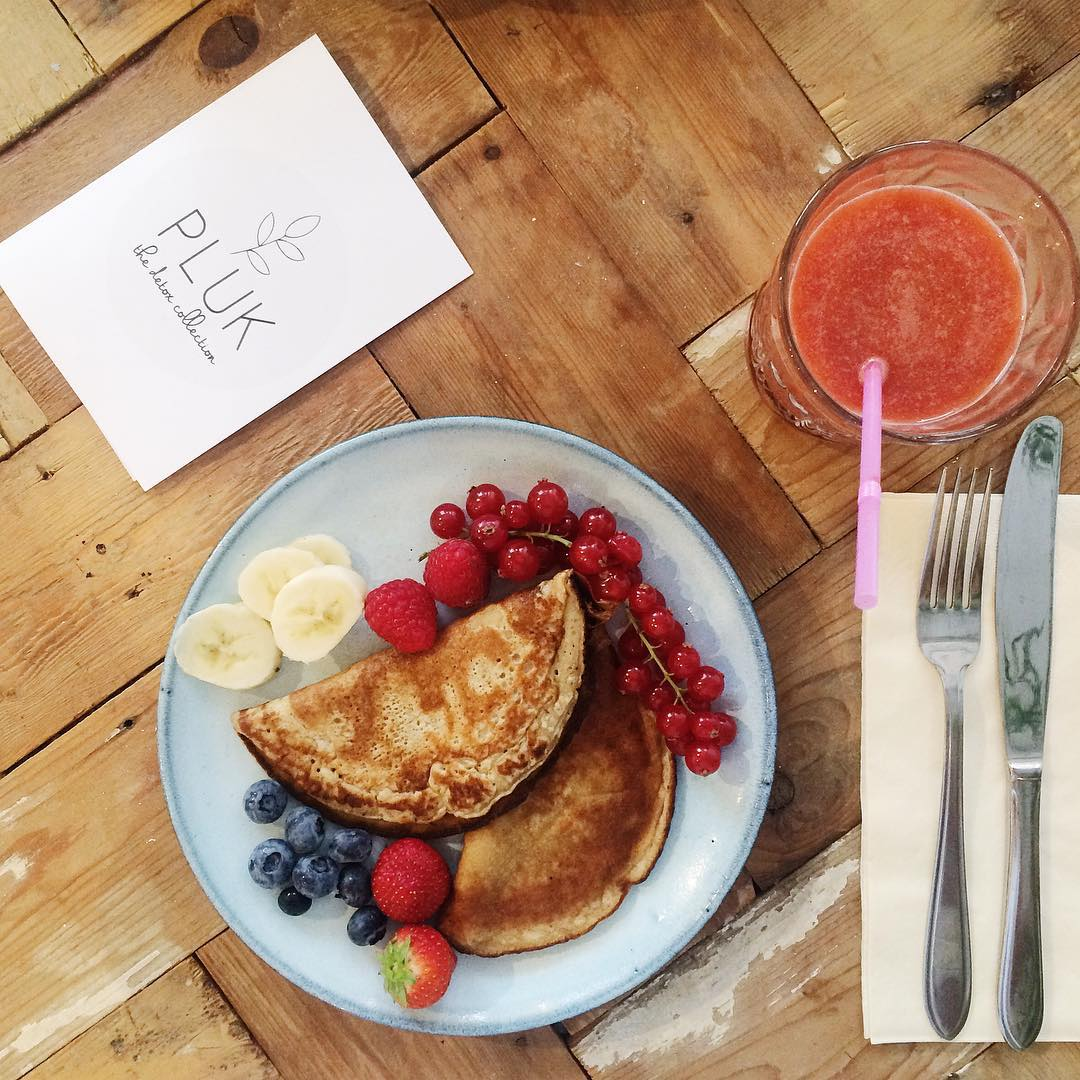 Delicious banana pancakes fresh fruits and a smoothie Let thehellip